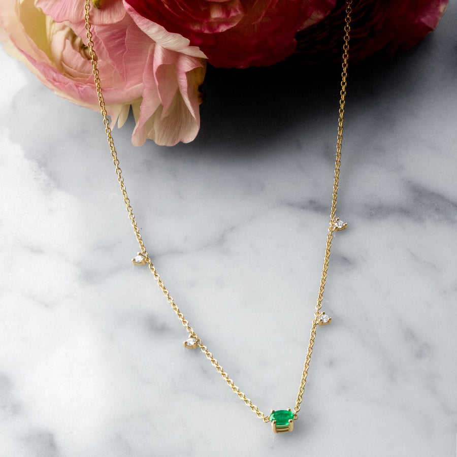 Camille Jewelry - 14 karat gold necklace with oval prong emerald center and small diamonds .