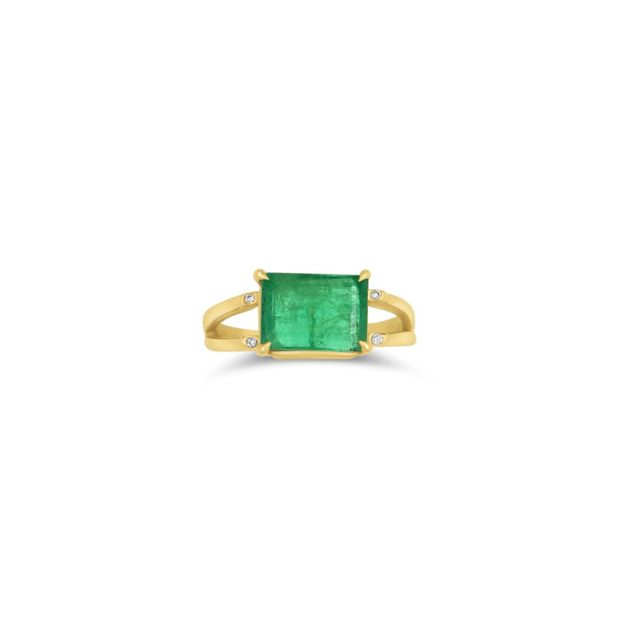Emerald cut emerald stone ring on a double band with small diamond accents | Camille Jewelry