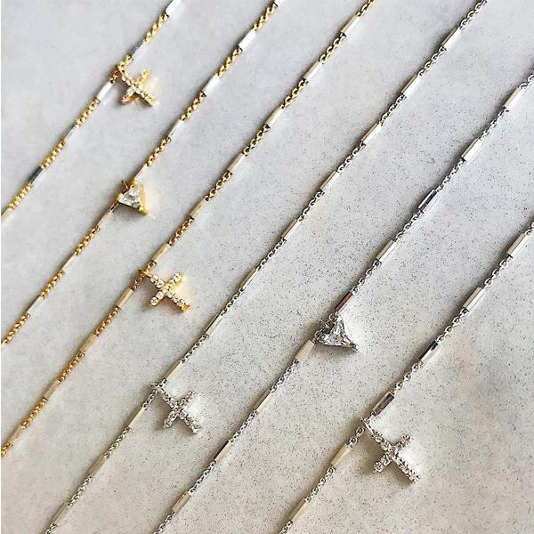 Shop dainty necklaces from Camille Jewelry. Pave cross and trillion style stering silver jewelry.