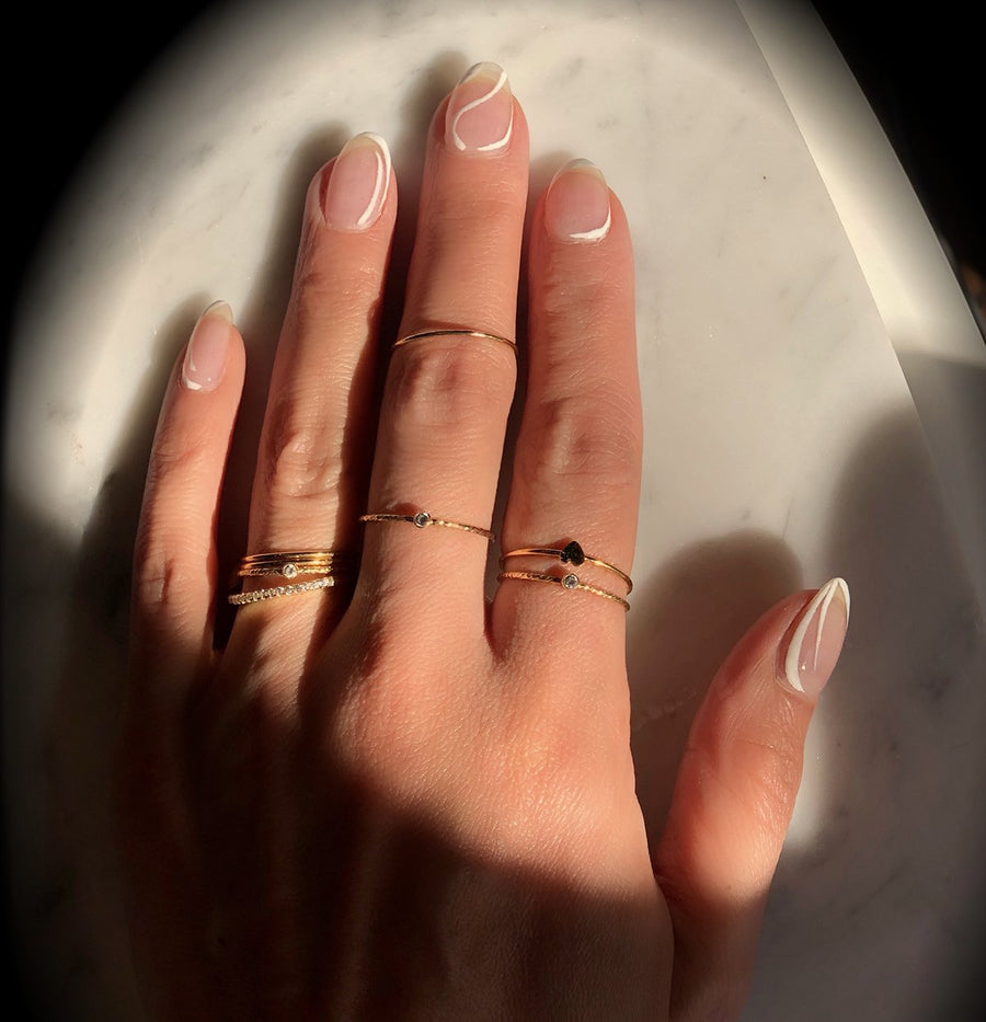 Skinny and delicate gold filled rings for stacking at Camille Jewelry