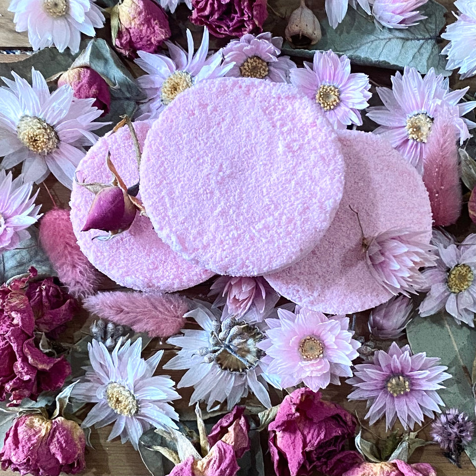 Handmade rose shower steamer for selfcare and body care containing rose essential oil