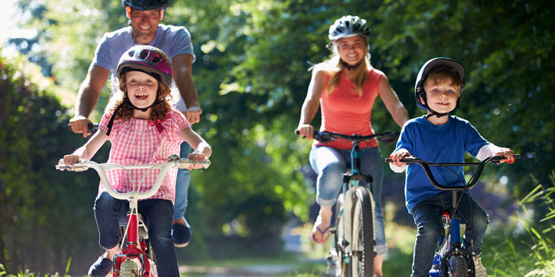 healthy family riding bikes