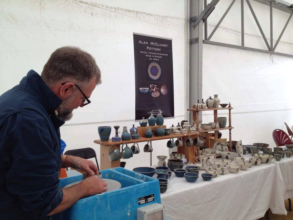Alan McCluney at work. Alan throws very fine porcelain bowls, cups, teapots and vases. His peacock glazing is a signature statement.
