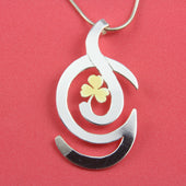 Intitials D and G made into a beautiful sterling silver pendant enhanced with a gold trefoil