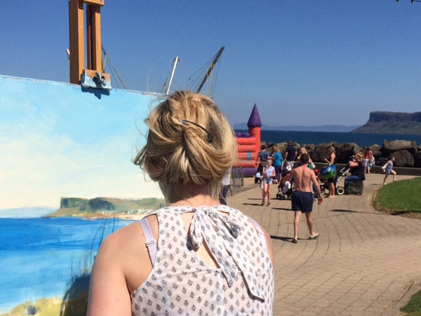Sarah Carrington doing a plein air painting demonstration during the Rathlin Sound Maritime Festival in Ballycastle