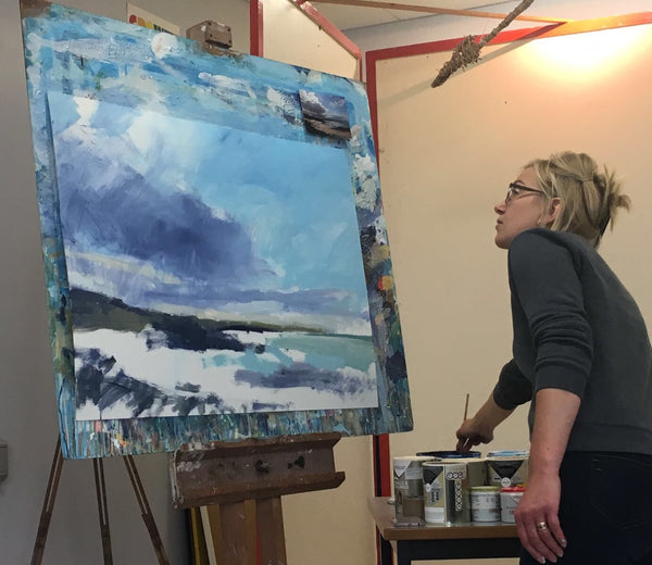 Sarah Carrington painting in her studio, her exhibition in the Puffin Gallery runs until the 5th July