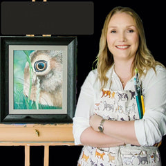 Portrait of Michelle Wilson in front of one her pencil drawings of a hare