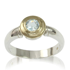 about-us-example-engagement-ring-blue-topaz-yellow-gold-setting-white-shank
