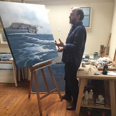 James McNulty adding the finishing touches to one of his oil seascape painting, Mist lifting on the north coast of IReland