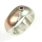 White gold wedding ring with a ruby and a dash of rose gold