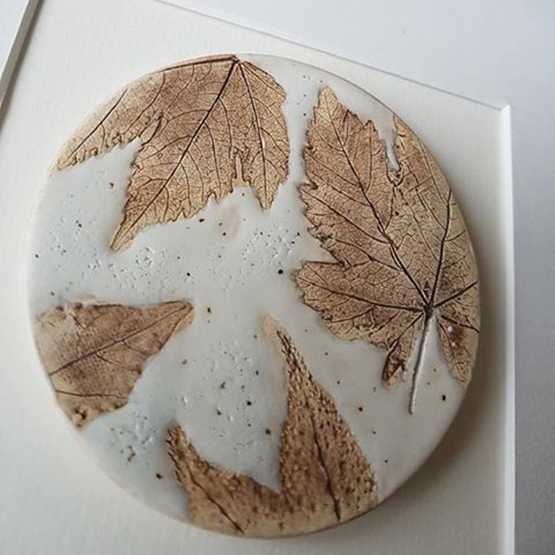 Ellen Cunningham is inspired by nature,  this porcelain work shows autumn leaves and is in autumnal colours.