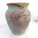 Ceramic vase in light purple pink glaze over cream with splashes of turquoise. Irish ceramicist Alan McCluney develops his range with trying different glazes and firing techniques. A must have in your home.