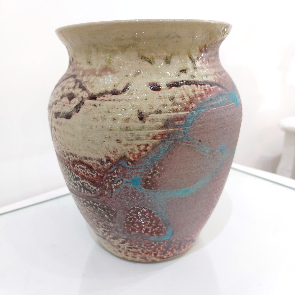 Multi-coloured ceramic vase including light pink to deep purple glaze on a cream background with splashes of turquoise. Flower vase or decorative item, you may use this ceramic piece as you wish.
