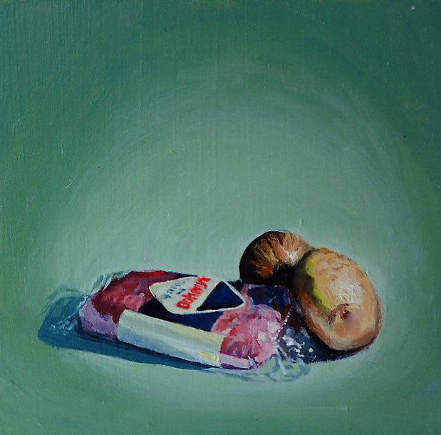 Typical Irish dinner includes sausages, potatoes (also known as spuds) and fried onions, this what Nadia Kaczmarczuk has painted in oil with a green background. All the ingredients are there for you to start cooking!