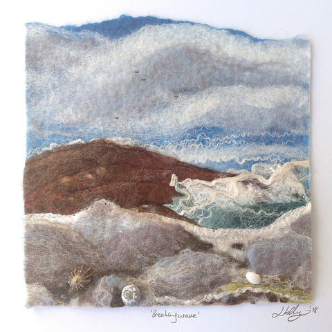 Breaking wave, an Irish seascape rendered in Felt (wool) by textile artist Louisa Kelly. Colours include turquoise, blue, brown, white and beige.