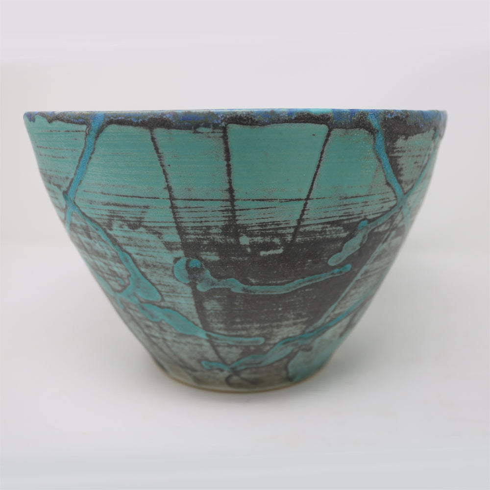 Side view of the large porcelain bowl. Colour of glaze is turquoise, light blue, traces of light and dark grey. Some of the glaze has been applied as droplets. Beautifully marked porcelain bowl.