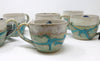 Turquoise and Cream Ceramic Coffee Mug by Alan McCluney