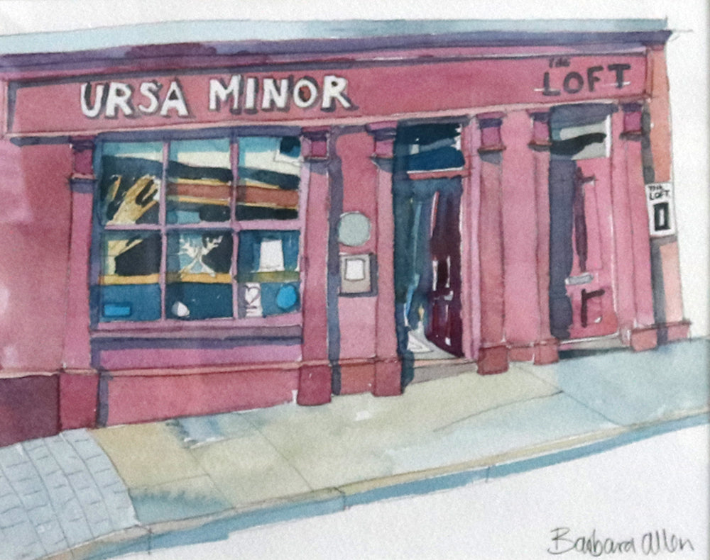 This watercolour painting is part of the collection of Ballycastle shop front paintings. This is Ursa Minor bakery front shop, traditional building features with pillars and a mauve pink colour as a theme. A fantastic eco friendly bakery which makes beautiful bread and pastries, make sure you pay a visit when you come to Ballycastle.