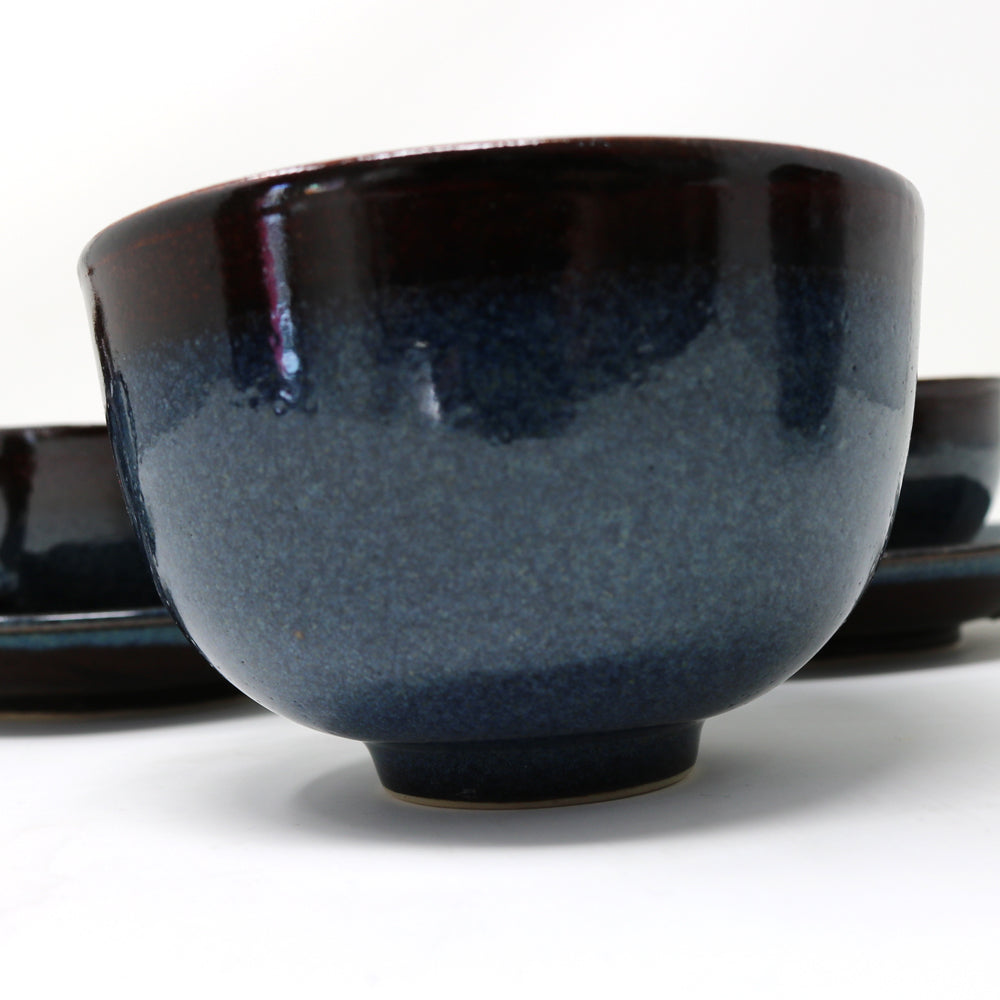 Beautiful dark blue glazed bowl with speckles of lighter blue grey. Part of an expresso service with cup and saucers.