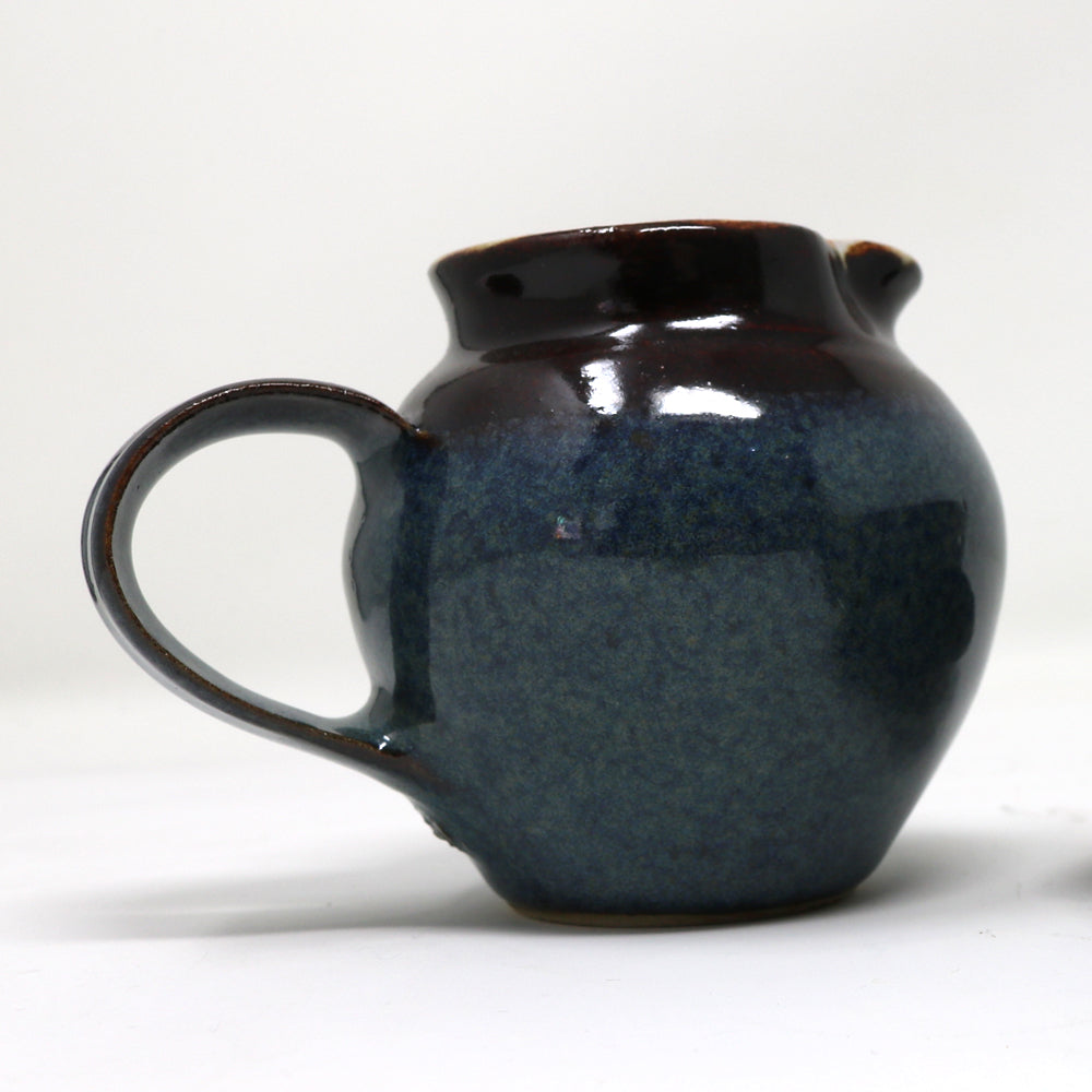 Dark blue Milk Jug by Claire Murdock