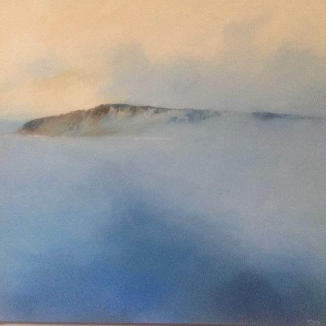 Lifting Mist is a beautiful oil landscape painting depicting a typical early morning Irish seascape, when the morning mist lifts to reveal a fantastic view across the water to the Northern coastline.