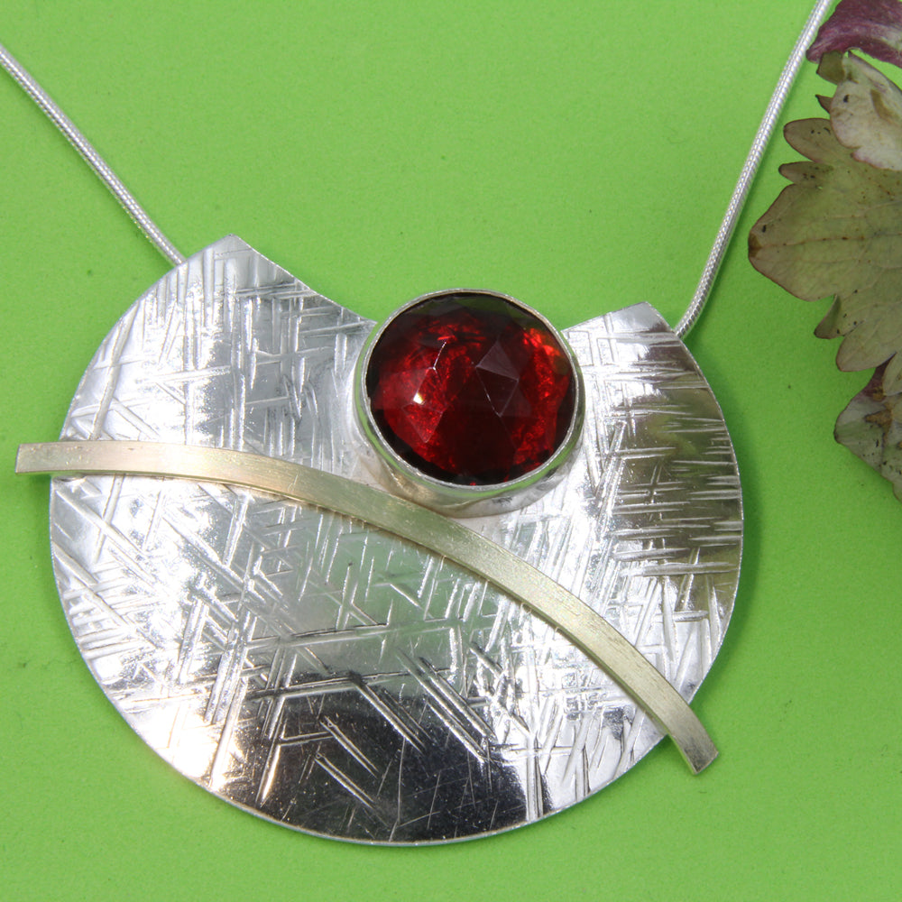 Round Faceted Red Stone Sterling Silver Pendant with Gold  by Robert Spotten