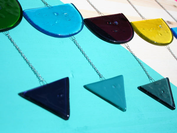 multicolored geometric triangle and circle fused glass mobiles