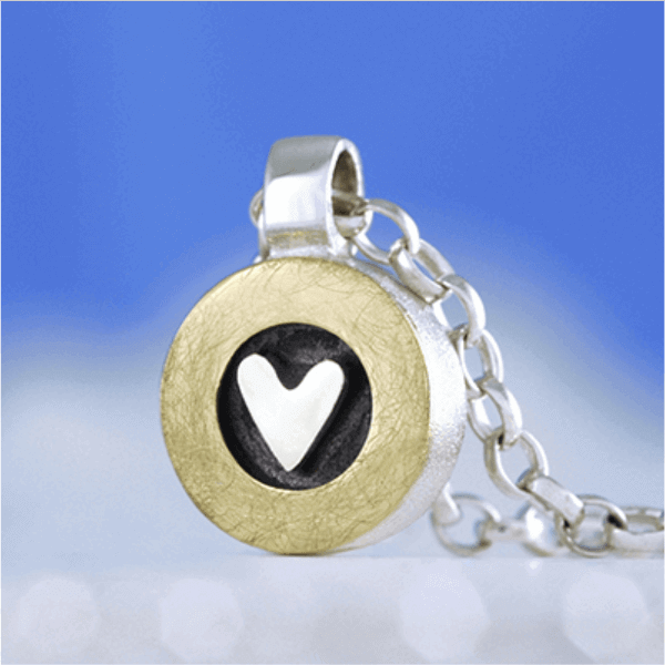 Silver heart with golden circle Pendant