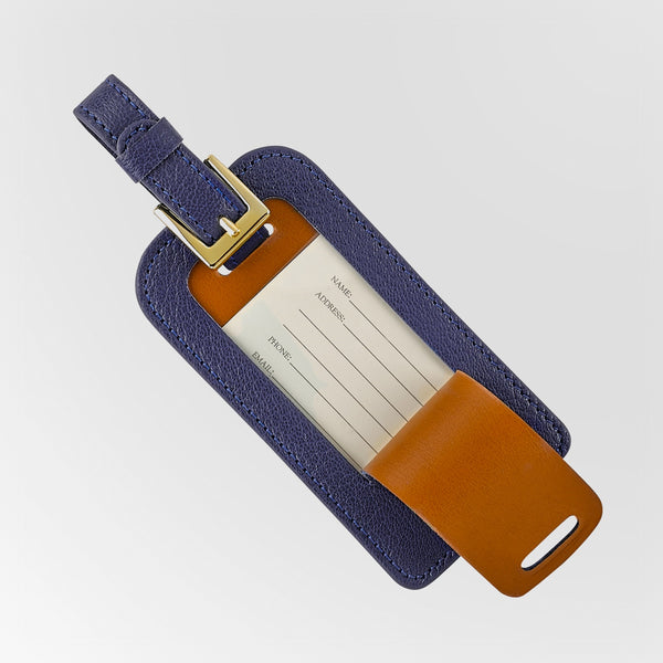 Leather luggage tag in navy shown open