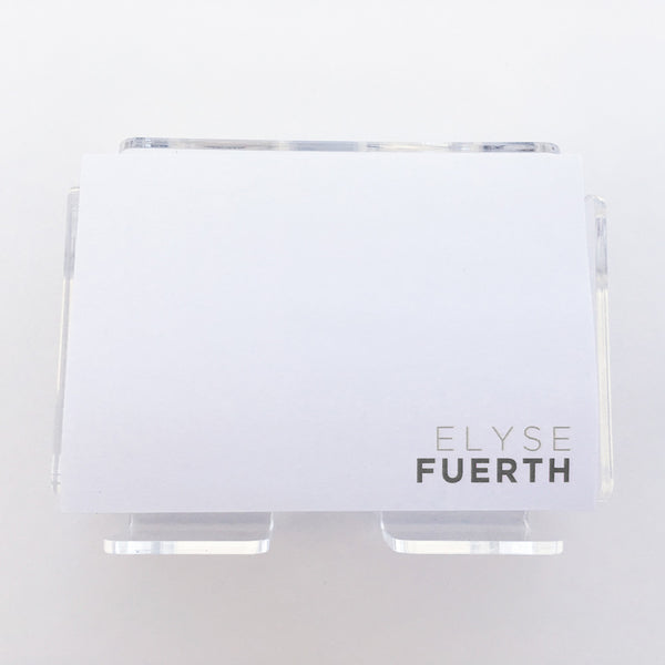 your name on a pad of post-its in grey ink with lucite holder