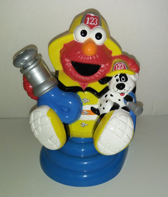 Elmo Sesame Street Grow With Me Fireman Sprinkler - We Got Character