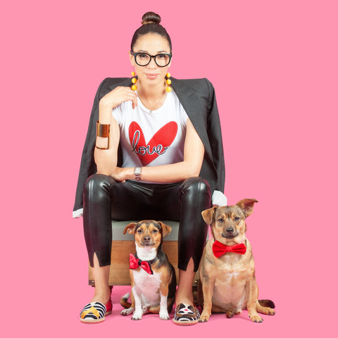 Isa Zapata and her two adopted dogs