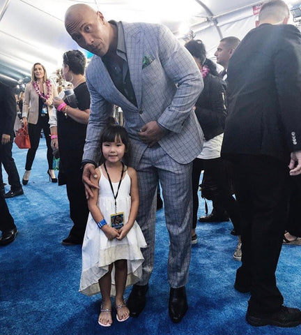 The Rock Dwane Johnson on the red carpet with his daughter who is wearing a windsong dress