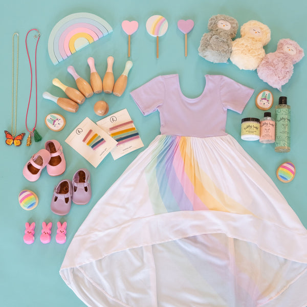 A flat lay of the pastel rainbow ballerina and the easter essentials