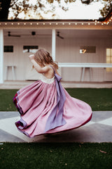 a child spinning in the winterberry chiffon dress