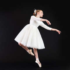 A ballerina dancing wearing the white swan dress