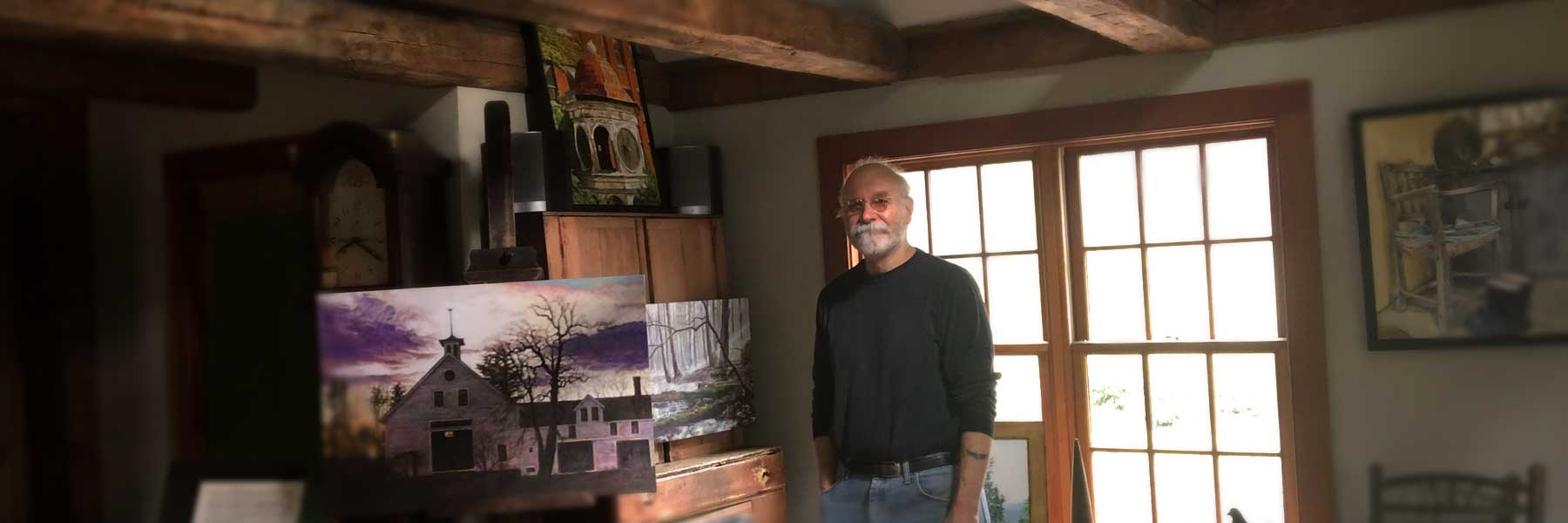 Tom Pirozzoli in his art studio painting