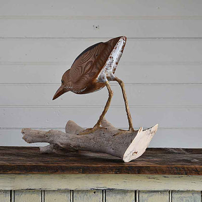 Hand-carved wooden bird sculpture by Wendy Lichtensteiger