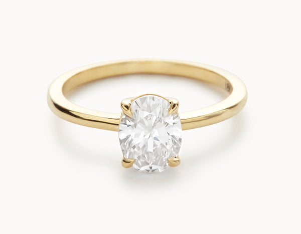 Minimal 18k Yellow Gold Oval Vertical Setting Diamond Engagement Ring