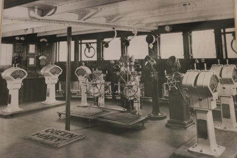 Hammerhead engine order telegraphs, binnacles and steering stations aboard the bridge of Ocean Liner Queen Mary