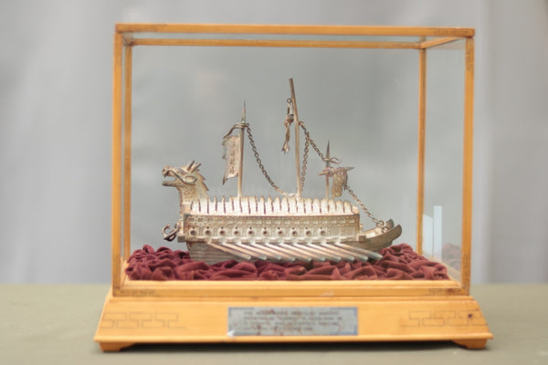 Cased model of an Asian Warship