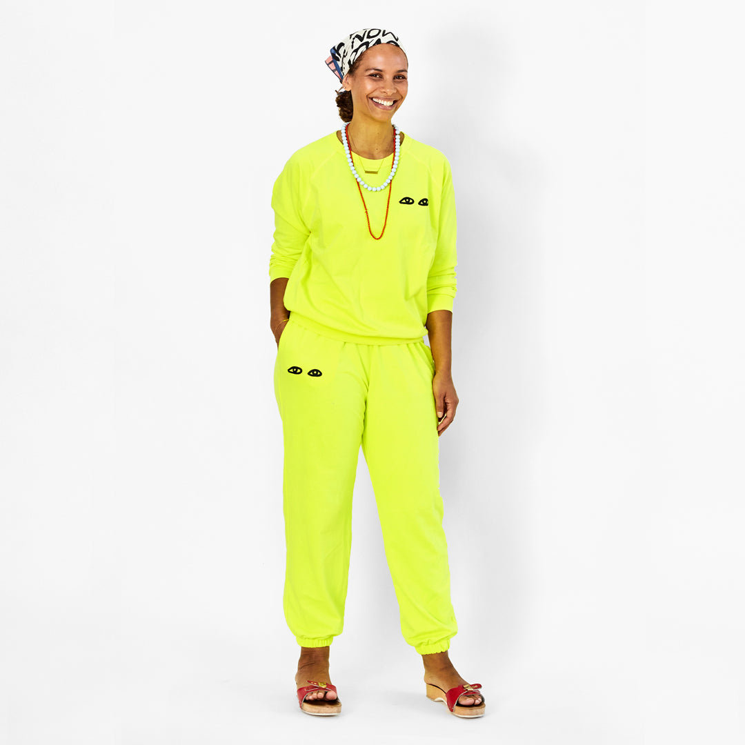 Neon Yellow with Black Eyes Sweatpants on Koa