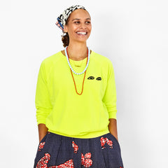 Neon Yellow with Black Eyes Sweatshirt on Koa