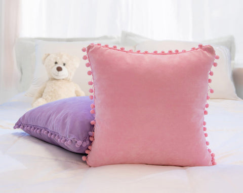 Pink and purple decorative throw pillows