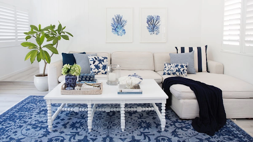 An image of a perfectly coordinated decorative cushion and throw interiors display