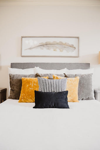 Finding the right-sized decorative cushions for your bed can really make a visual impact