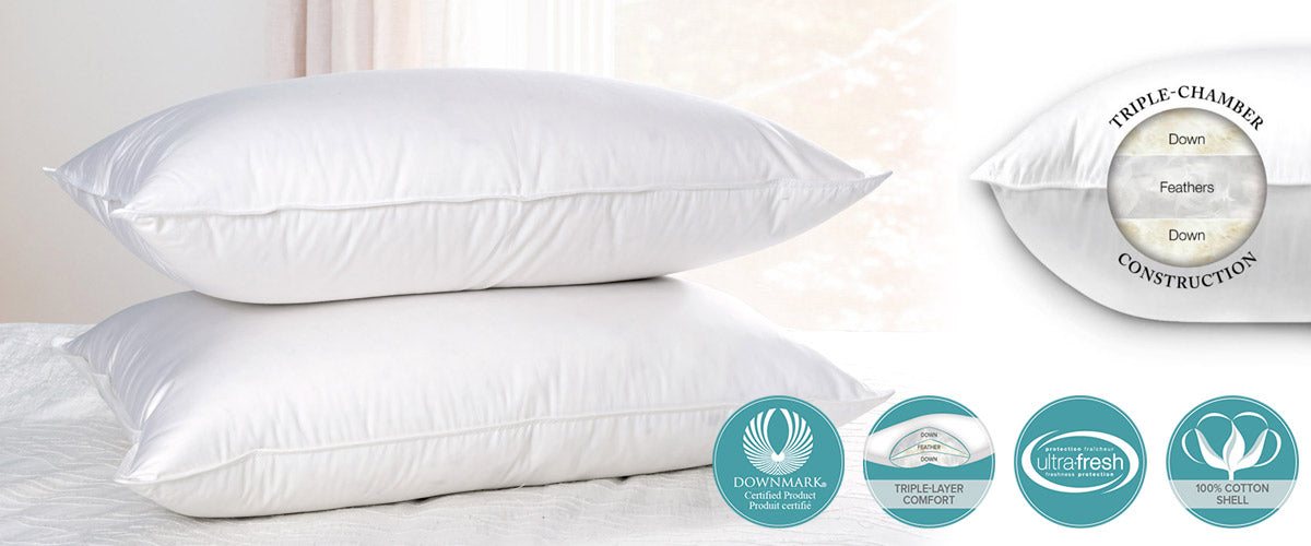 pillows on the bed with showing opening with feather and down