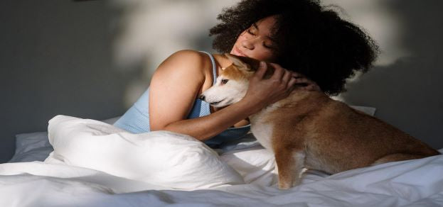 Woman and a dog in bed