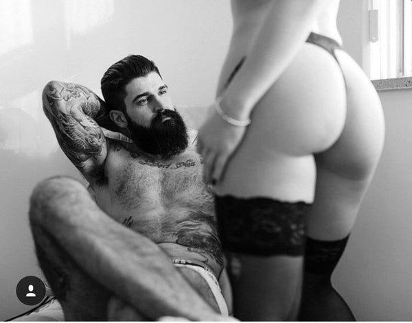 bearded man with sexy woman