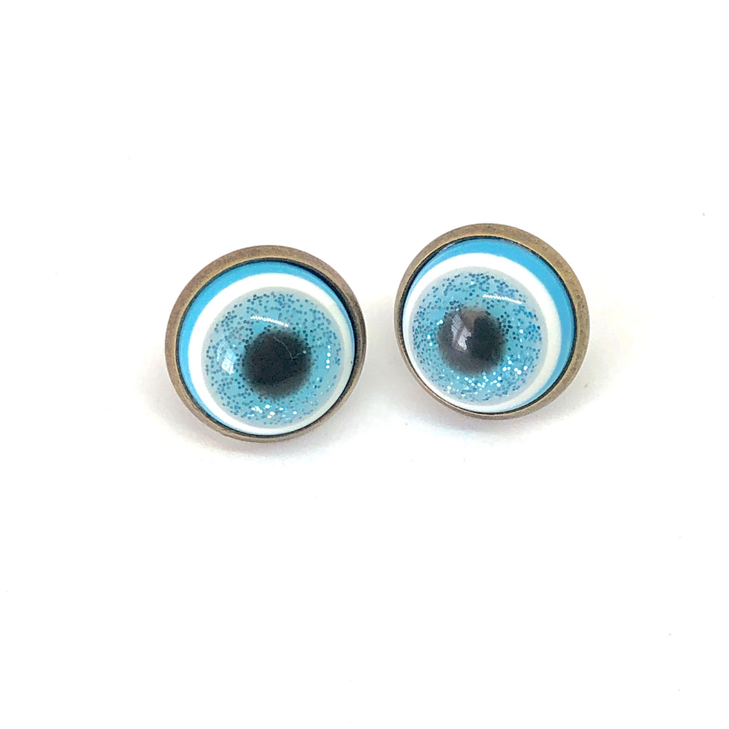 Eyeball stud earrings. Spooky Halloween earrings. Glittery blue earrings. Resin stud earrings. Halloween party accessories. Gifts under 10.